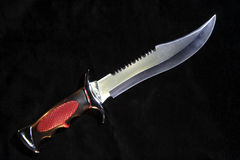 Hunting knife over black Royalty Free Stock Photos