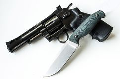 Hunting knife and revolver. Weapons of the military. stock image