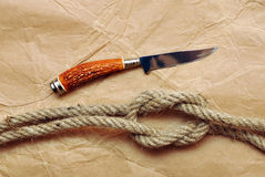 Hunting knife and rope Royalty Free Stock Images