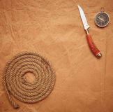 Hunting knife, rope and compass Royalty Free Stock Images
