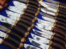 Hunting knives on the blue background. Moscow International Exhibition Arms and Hunting. October, 2013 Stock Photography