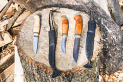 Hunting knives on wooden stump Royalty Free Stock Photos