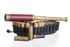Hunting leather bandolier and spyglass royalty free stock photos