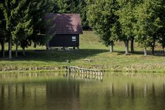Hunting lodge on the shore of a pond Royalty Free Stock Image