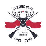 Hunting logo, vintage emblem with deer head and crossed hunting rifles Royalty Free Stock Photos