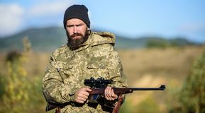 Hunting masculine hobby. Man brutal gamekeeper nature background. Bearded hunter spend leisure hunting. Hunter hold