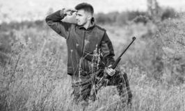 Hunting permit. Bearded hunter spend leisure hunting. Hunter hold rifle. Focus and concentration of experienced hunter. Hunting and trapping seasons. Man royalty free stock photography