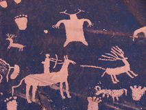 Hunting petroglyph Stock Images
