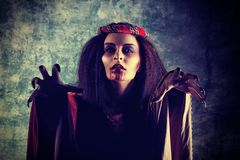 Hunting for prey. Portrait of a bloodthirsty female vampire stock photography