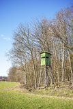 Hunting pulpit at the edge of a forest in spring. Royalty Free Stock Photo