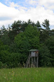 Hunting pulpit. In the meadow near the forest Stock Photos