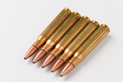 30-06 hunting rifle ammunition. Five .30-06 caliber hunting rifle cartridges in a row on a white background Stock Photo