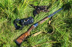 Hunting rifle, ammunition and a trophy hunter Royalty Free Stock Photo