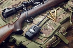 Hunting rifle and equipment. Hunting rifle with optical sight and equipment Stock Image