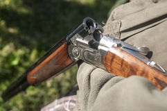 Hunting rifle. In hunters hand Stock Image