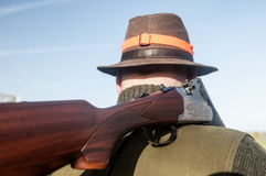 Hunting rifle. On hunters shoulder Stock Images