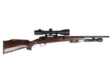 Hunting rifle. Studio shot of hunting scoped rifle. 2.5-10 x 50 optic and caliber 22-250 Royalty Free Stock Photo