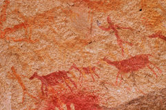 Hunting Scene in Ancient Cave Paintings. Ancient Cave Paintings in patagonia stock image