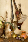 Hunting scene. Autumn still life with hunting rifle, pheasant and hare Stock Photography