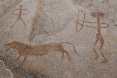 A hunting scene on the wall of the cave. Royalty Free Stock Photo