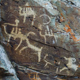 Hunting scenes palaeolithic Petroglyphs. Carved in rocks. Hunters on camels. Stones with petroglyphs in the Chuya Steppe, Kuray steppe in the Siberian Altai Stock Photography