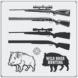 Hunting set. Vector monochrome illustration of a Wild Boar and Hunting rifles. Stock Photos