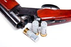 Hunting shotgun and ammunition on white background. Royalty Free Stock Photos