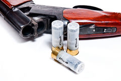 Hunting shotgun and ammunition on white background. Royalty Free Stock Photos