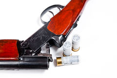 Hunting shotgun and ammunition on white background. Royalty Free Stock Photography