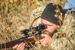 Hunting skills and weapon equipment. How turn hunting into hobby. Bearded man hunter. Army forces. Camouflage. Military. Uniform fashion. Man hunter with rifle stock photo