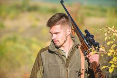 Hunting skills and weapon equipment. How turn hunting into hobby. Bearded man hunter. Army forces. Camouflage. Military. Uniform fashion. Man hunter with rifle stock photography