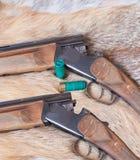 Hunting smooth-bore gun. Lies on Fox skin stock images