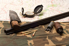 The hunting still-life. Subjects of the hunting ammunition on a camouflage fabric Royalty Free Stock Photos