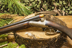 Hunting still life. Beautiful antique hunting rifle and hunting Royalty Free Stock Image