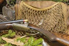Hunting still life. Beuatiful hunting rifle and hunting equipment Stock Image