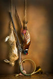 Hunting still life. With hare and pheasant in old master painting style Stock Photos