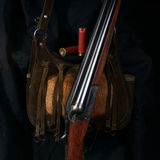 Hunting Still Life 1. Shotgun, hunting bag and spent shells composed for a still life Royalty Free Stock Photography