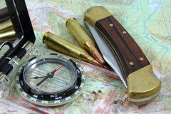 Hunting Tools. A collection of items used in outdoor pursuits, a nice, bullets, and a modern compass Royalty Free Stock Photo