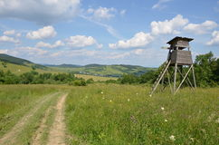 Hunting tower. There is a hunting tower in the meadow Royalty Free Stock Images