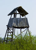 Hunting tower in the forest for wildlife viewing and hunting Royalty Free Stock Photography