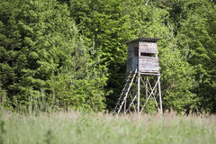 Hunting tower on the lawn Royalty Free Stock Photography