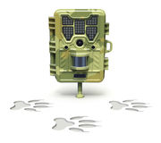 Hunting trail camera. Over animal footprint on white background - 3D illustration Royalty Free Stock Image