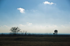 Hunting watchtower on a meadow at sunny autumn day, Deliblatska pescara stock image