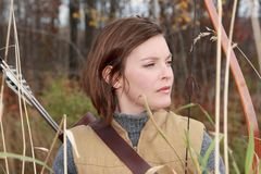 Hunting woman. Portrait of hunting woman with a bow Stock Images