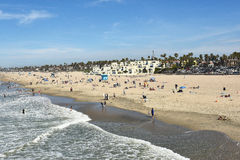 Huntington Beach California Shoreline. HUNTINGTON BEACH, CA - MARCH 25, 2015: Huntington Beach Shoreline with lifeguard stations and beach goers on a sunny day Stock Photos