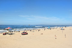 Huntington Beach California Shoreline. HUNTINGTON BEACH, CA - MARCH 25, 2015: Huntington Beach Shoreline with lifeguard stations and beach goers on a sunny Royalty Free Stock Image