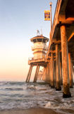 Huntington Beach Pier, California. Huntington Beach Pier in Southern California. The morning light hits the side of the pier giving it a nice glow stock photo