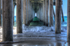 Huntington Beach pier in HDR 2015. Huntington Beach under the pier in HDR 2015 .Picture taken by Luigi D 09-29-15 Royalty Free Stock Photos