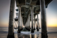 Huntington Beach Pier. Long exposure captures slow moving waves under The Huntington Beah Pier in Huntington Beach, California Royalty Free Stock Image