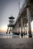 Huntington Beach Pier. Long exposure captures slow moving waves under The Huntington Beah Pier in Huntington Beach, California Stock Photo